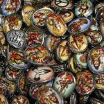 assorted enameled pendants
