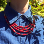 Red Multistrand Necklace shown being worn