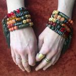 10pc assortment of fancy tassel bracelets- shown being worn