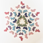 mandala made from ceramic unicorn critter beads in assorted colors