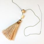 tassel and guru bead shown being strung together