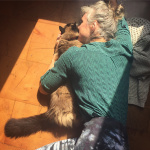 Tika girl Corrine cuddling with Bodhi the office kitty