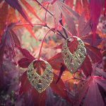 Handcrafted brass earrings with sterling silver earwires, shown out in nature
