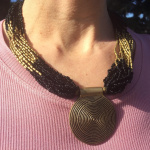 Beaded Naga Style Necklace in black, being worn outdoors