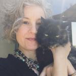 Tika girl Corrine cuddling with Poppy the office kitty