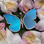 large blue butterfly pendant nestled in Spring flowers