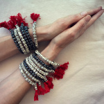 new carved bone mala bracelets shown being worn with hands in prayer