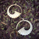 carved shell earrings shown outdoors