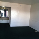 the empty hotel room before Tika arrives