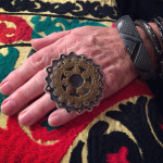 vintage gilgit brass button featured on a ring made by designer Sally Bass