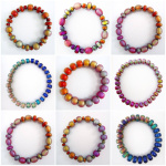 an assortment of Original and Hot Pink Mirage Bead Bracelets, showing the wide range of colors