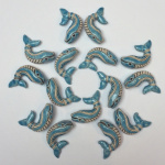 mandala made from ceramic whale critter beads