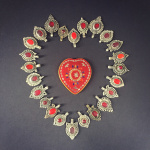 sweetheart mirror and tribal gypsy glass pendants laid out in the shape of a heart