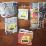 recycled newspaper gift bags shown in assorted sizes