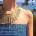 Sun Ray Necklace shown being worn