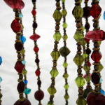 Gaia Necklaces, back-lit to show translucency of glass beads