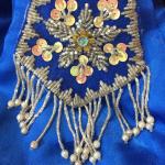 Beaded mandala detail on a Vintage Wayang Puppet