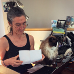 Julie and office kitty Bodhi, working at Julie's desk