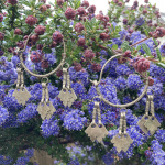 Tribal chic earrings displayed out in nature