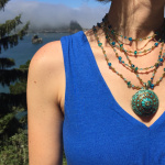 Gaia necklaces shown being worn with a Tibetan Style Pendant
