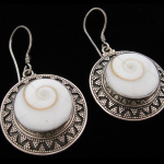 Sterling silver earrings featuring natural Eye of Shiva shell with decorative silver granulation