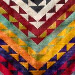 closeup detail of vintage Uzbeck textile showing cross-stitch embroidery