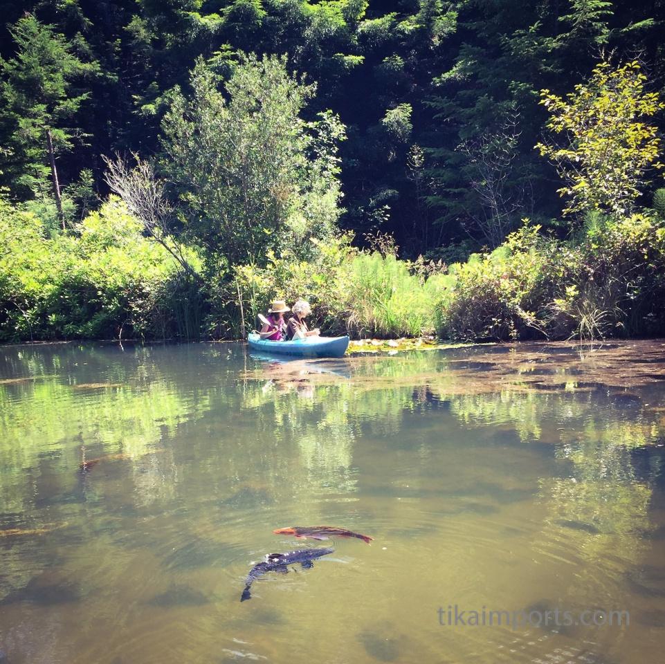 Tika girls paddle around the pond