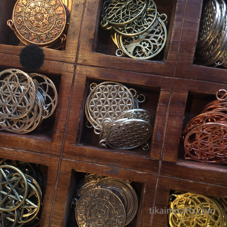 closeup texture detail of sacred geometry pendants
