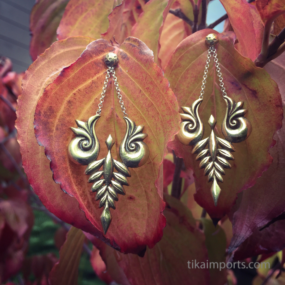 Handcrafted brass earrings with solid sterling silver earwires shown out in nature