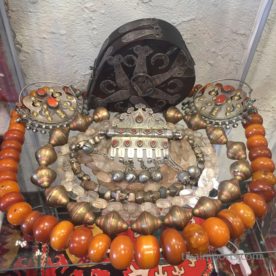 display of antique beads and jewelry
