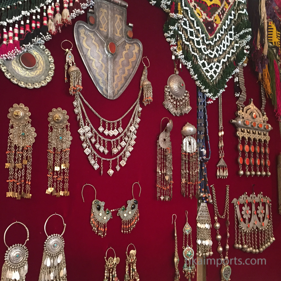 display of antique jewelry and textiles