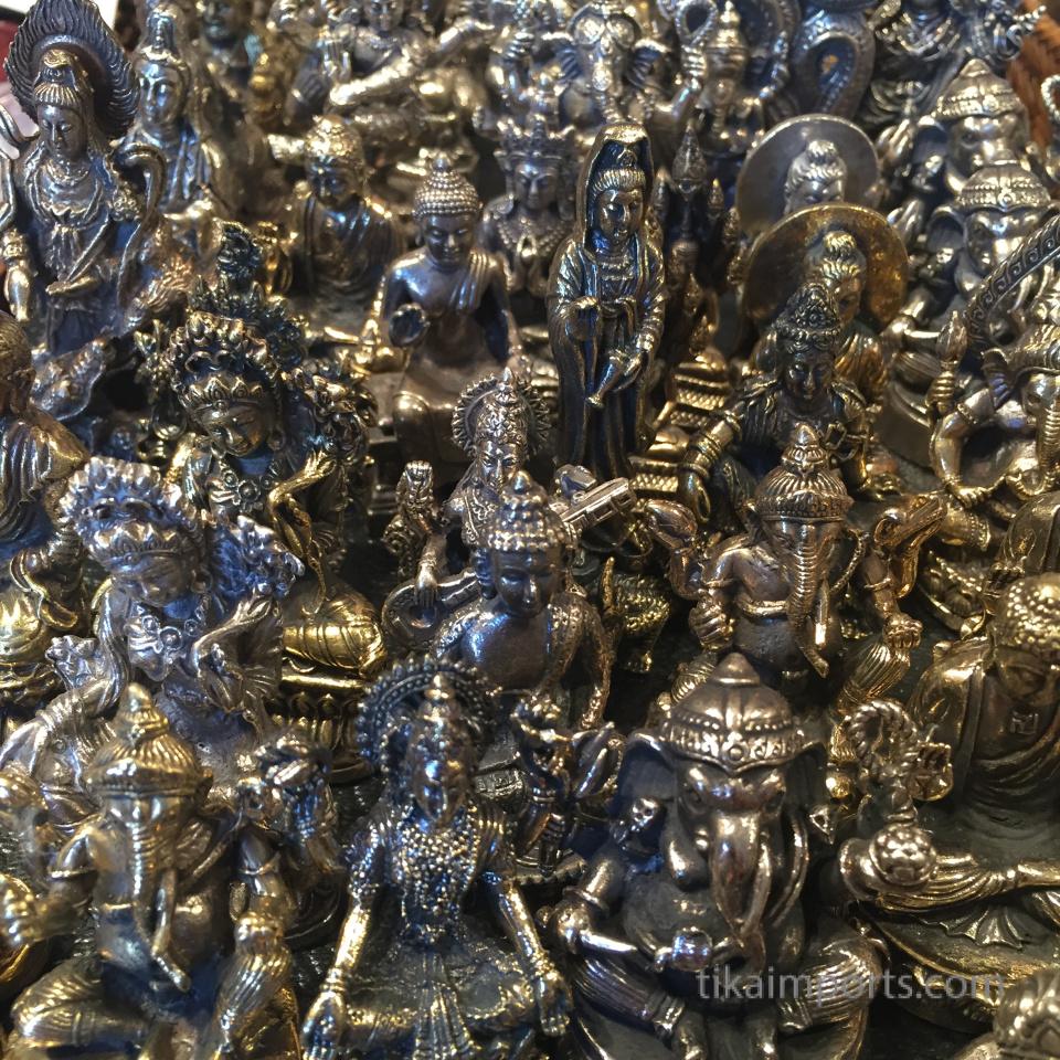 closeup texture detail of brass deity statues