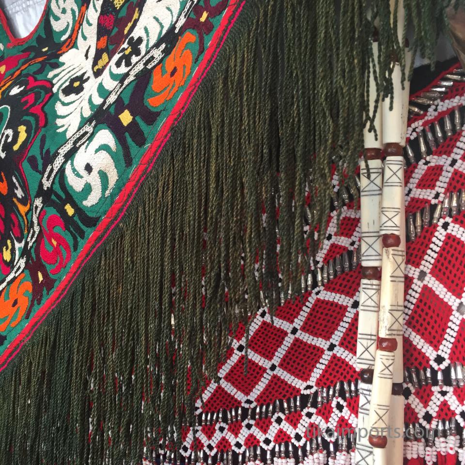 closeup texture detail of beads and textiles