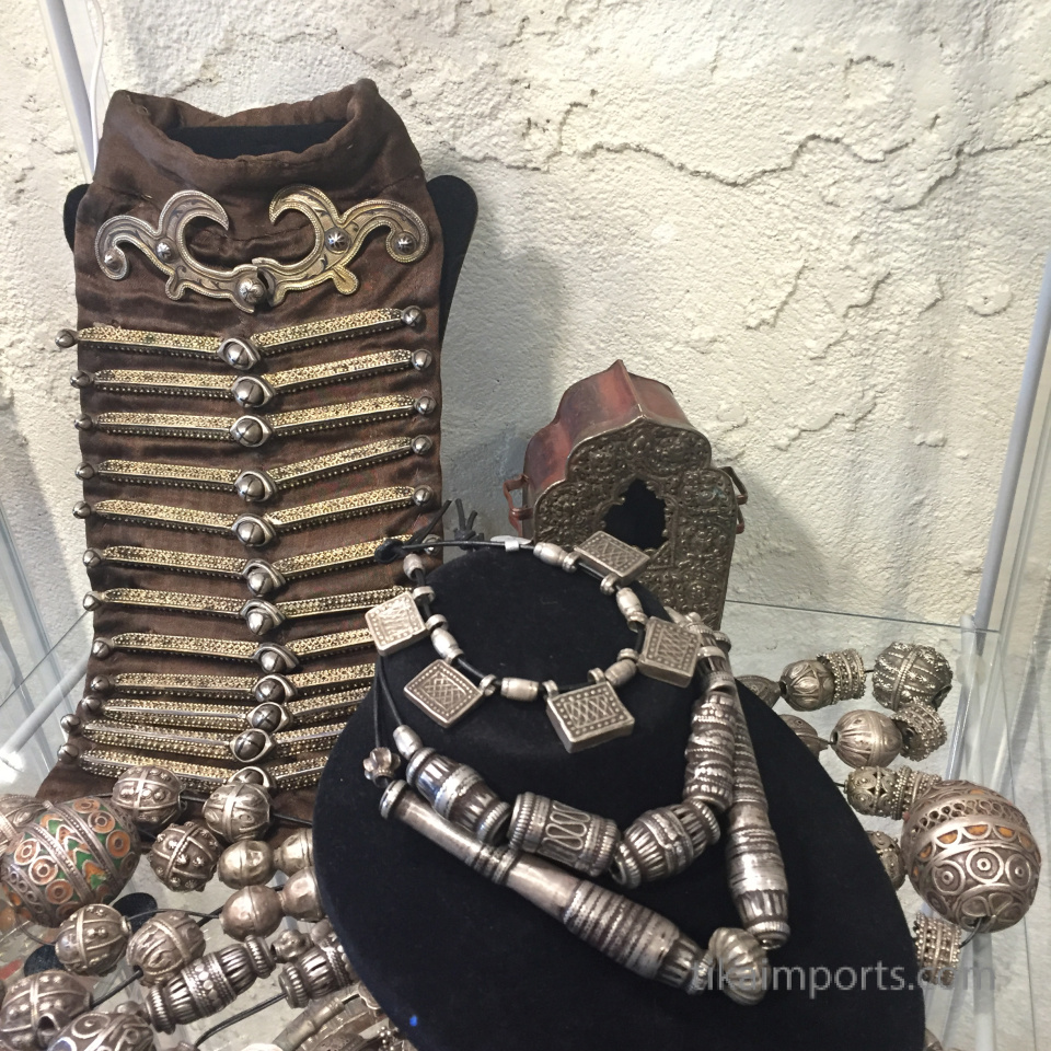 display of antique silver beads and buttons