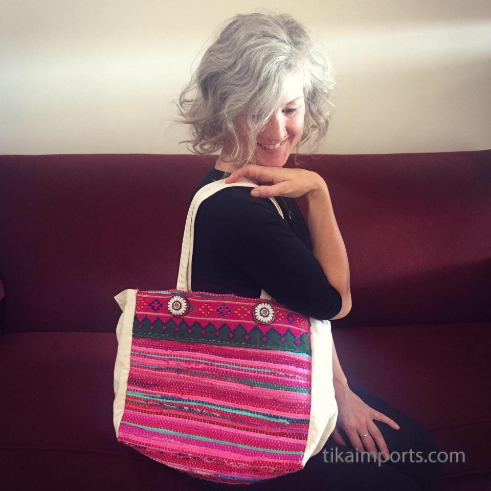 Tika girl Corrine with her customized bag