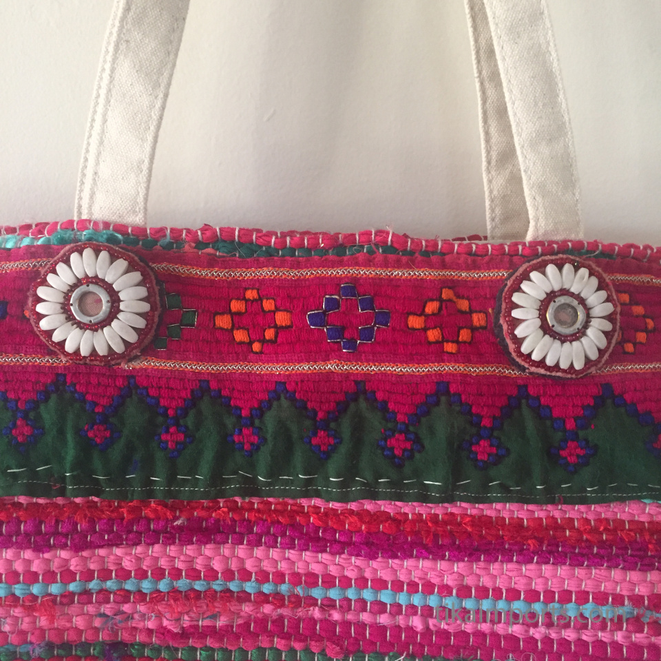 custom bag embellished with Tika items- closeup of dress flowers and Afghani textile