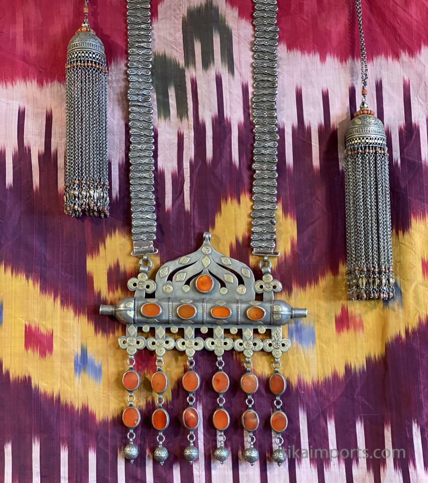 antique jewelry displayed with an antique ikat silk robe