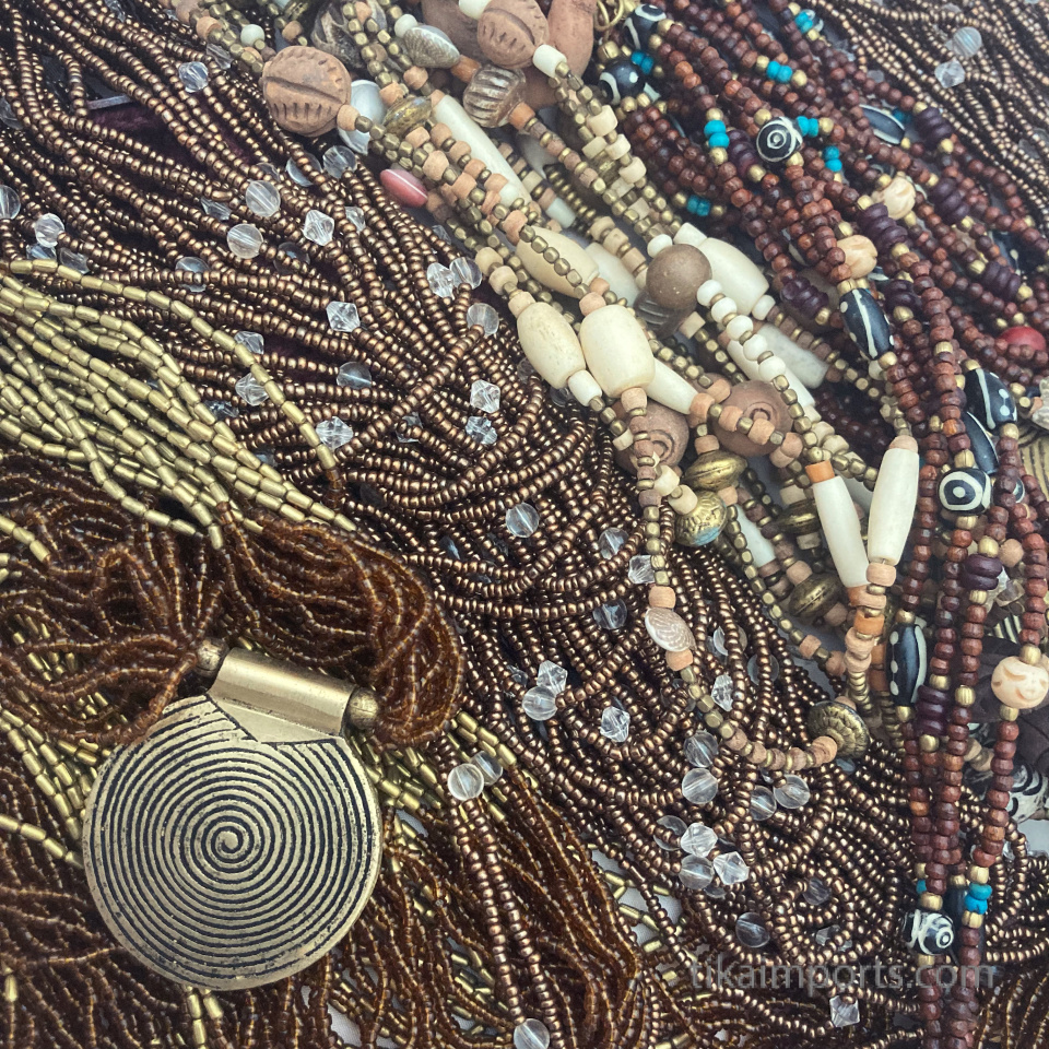 an assortment of beaded necklaces in rifh Fall colors