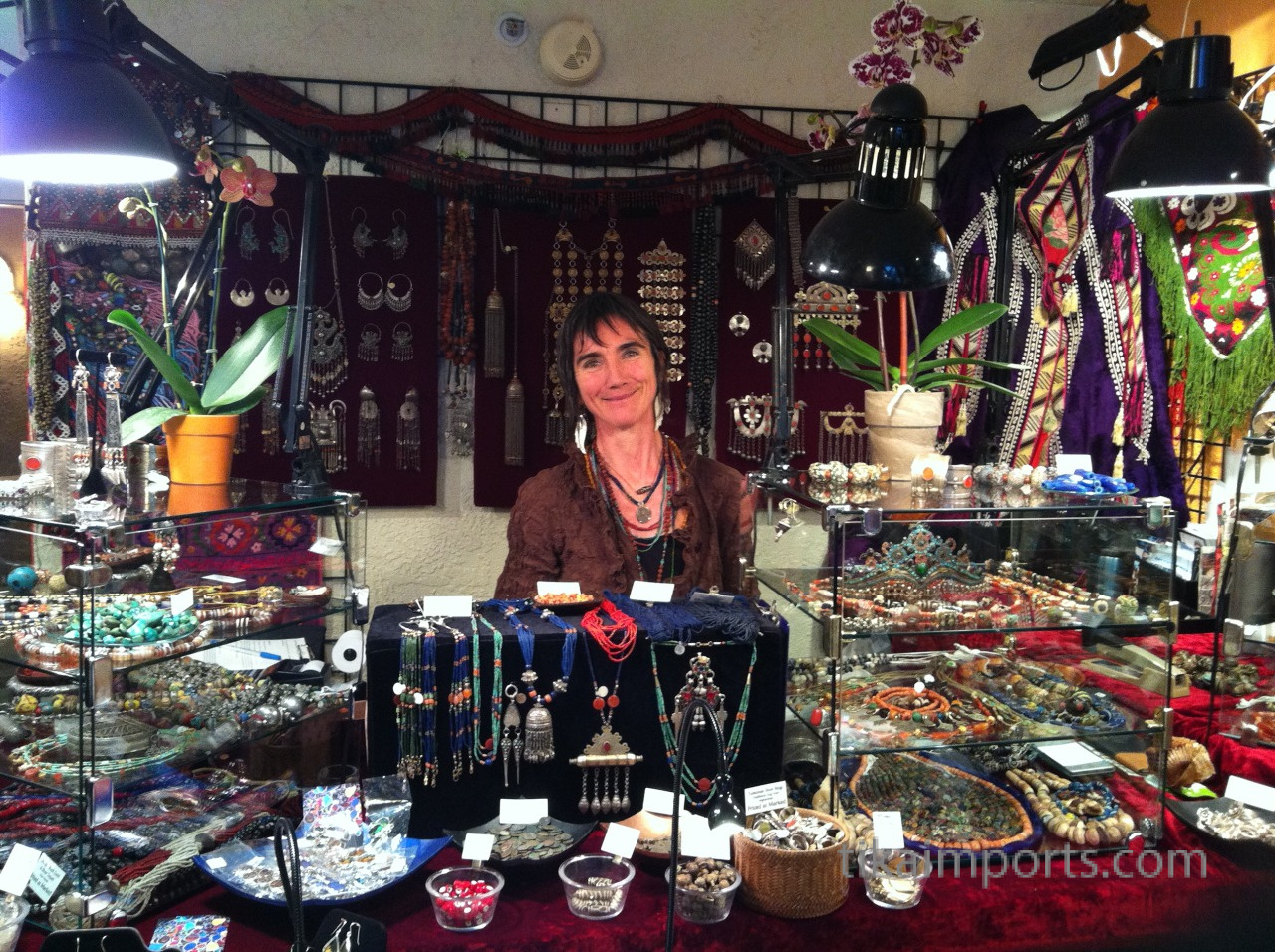 Julie surrounded by Tika merchandise