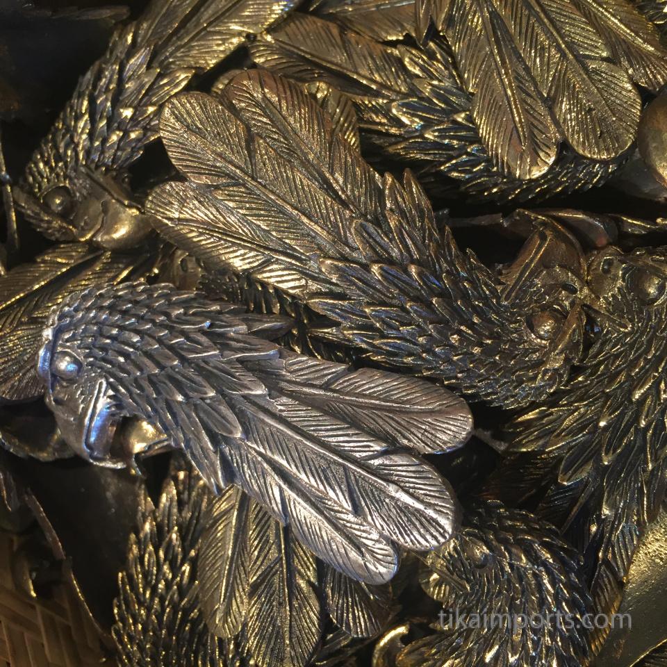 closeup texture detail of brass eagle pendants