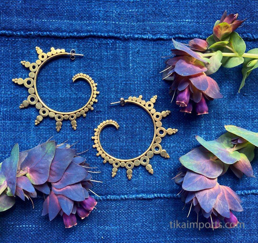 Odyssia brass earrings nestled in spring flowers