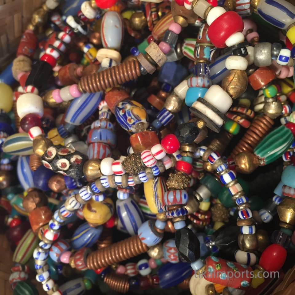 closeup texture detail of small african trade bead bracelets