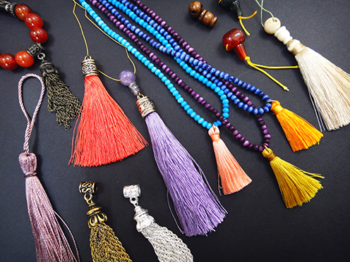 assorted guru beads and tassels to make your own mala